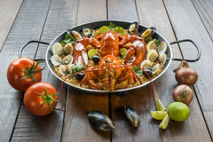Paella with fresh lobster, clams, mussels and lime Royalty Free Stock Photos