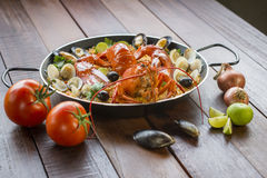 Paella with fresh lobster, clams, mussels and squid Stock Images