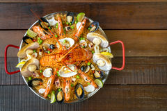 Paella with fresh lobster, scollops, mussels and prawn Royalty Free Stock Image