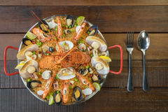 Paella with fresh lobster, scollops, mussels and prawn Royalty Free Stock Images