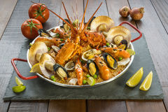 Paella with fresh lobster, scollops, mussels and prawn Stock Photos
