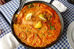Paella. Freshly cooked paella with shrimp and mussels on the table Stock Images