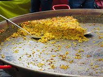 Paella on giant frying pan done at the carnival Stock Photography