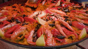 Paella on the market in the pan wok closeup stock footage