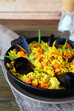 Paella with mussels in a pan Royalty Free Stock Images