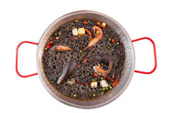 Paella negra on the pan Stock Photos