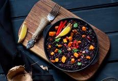 Paella noire de riz Photo libre de droits
