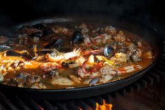 Paella over open fireplace Stock Photography
