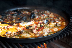 Paella over open fireplace Royalty Free Stock Image