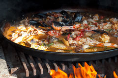 Paella over open fireplace Royalty Free Stock Photo