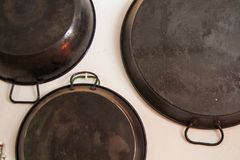 Paella pan hanging. In a white wall royalty free stock image