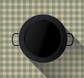 Paella pan on tablecloth Stock Image