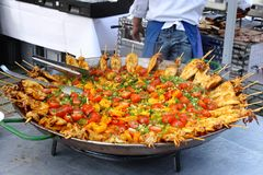 Paella prepared in a giant pan, at a big Silvester party