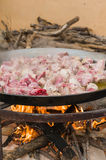 Paella preparing. Huge frying pan with chicken pieces. Traditional spanish paella preparing Royalty Free Stock Images