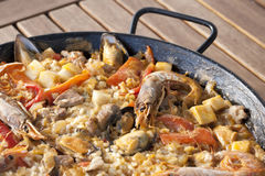 Paella rice. With prawns cooked in a barbecue fire Stock Photo