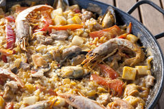 Paella rice. With prawns cooked in a barbecue fire Royalty Free Stock Image