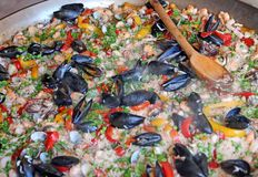 Paella rice with clams and mussels and green peas Stock Photos