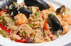 Paella rice with mussels and shrimp and green peas Royalty Free Stock Photography