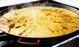 Paella rice from Valencia Spain cooking in big pan Royalty Free Stock Photo