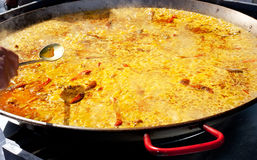 Paella rice from Valencia Spain cooking in big pan. Paella rice typical from Valencia Spain cooking in big pan stock image