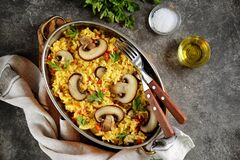 Paella or risotto with mushrooms, bell peppers, carrots, onions, white wine and olive oil. Homemade healthy food. Food meal