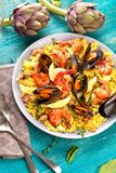 Paella with seafood. Traditional spanish food closeup on wooden table. royalty free stock images
