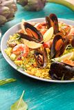 Paella with seafood. Traditional spanish food closeup on wooden table. stock image