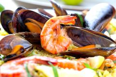 Paella with seafood. Traditional spanish food closeup on wooden table. stock photo