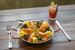 Paella with seafood vegetables and saffron served in the traditi Stock Photo