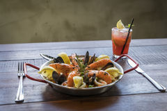 Paella with seafood vegetables and saffron served in the traditi Royalty Free Stock Image