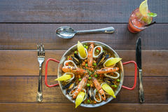 Paella with seafood vegetables and saffron served in the traditi Royalty Free Stock Photos