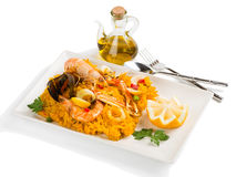 Paella with seafood in a white plate Stock Photo