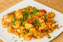 Paella serving on a plate. royalty free stock photos