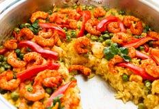 Paella with shrimps, partially eaten. Paella with shrimps and vegetables, partially eaten Stock Image