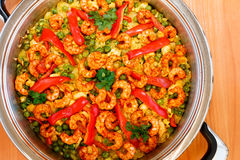 Paella with shrimps. At table Royalty Free Stock Photo