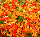 Paella with shrimps and vegetables, close-up. Paella with bared shrimps and vegetables, close-up Royalty Free Stock Images