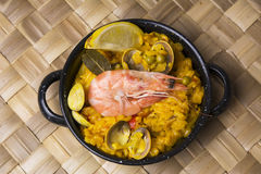 Paella small, typical Spanish rice with seafood in individual po Royalty Free Stock Photos