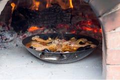Paella. On the stone oven Stock Photos