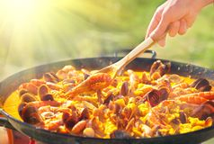 Paella. Traditional spanish food, seafood paella in the fry pan with mussels, king prawns and squids. Paella. Traditional spanish food, seafood paella in the fry royalty free stock images