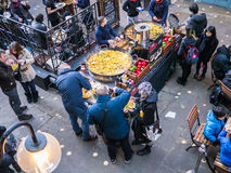 Paella tubs at Covent Garden, surrounded by diners, as seen from above, London, UK. Royalty Free Stock Photography