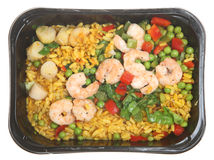 Paella TV Dinner. Ready meal of paella with king prawns and scallops Royalty Free Stock Images