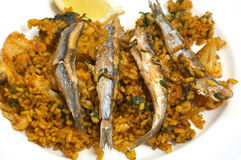 Paella/typical spanish dish with rice. And fish Stock Image
