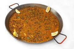 Paella/typical spanish dish with rice. On white background Stock Photos