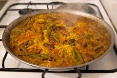 Paella up close stove top stock photos