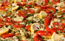Paella valenciana with seafood and vegetables Royalty Free Stock Photography