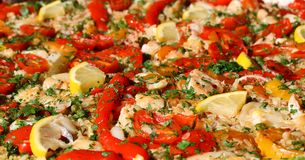 Paella valenciana with seafood and vegetables Stock Photography