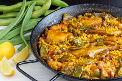 Paella Valenciana - Spanish Food. Traditional Paella Valenciana is a great dish to share with family and friends Royalty Free Stock Images