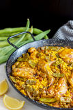 Paella Valenciana - Spanish Food. Traditional Paella Valenciana is a great dish to share with family and friends Stock Photo
