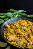 Paella Valenciana - Spanish Food. Traditional Paella Valenciana is a great dish to share with family and friends Stock Photos