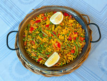 Paella and vegetables, vegetarian recipe. Traditional Spanish rice: Paella and vegetables - Vegetarian recipe Royalty Free Stock Photo